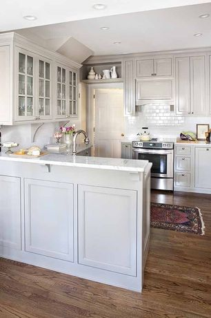 Traditional Kitchen with Flat panel cabinets, Complex marble counters, Ms international - calacatta classic marble, U-shaped