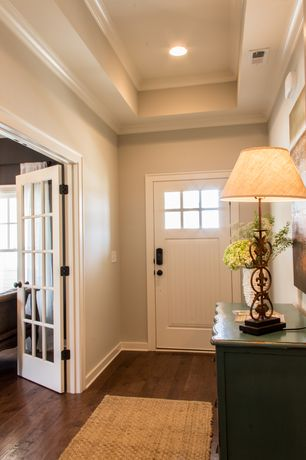 Craftsman Entryway with Paint, Traditional metal table lamp, Antique finish dresser, French doors, Seagrass runner