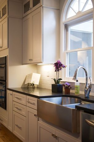 Traditional Kitchen with Subway Tile, Soapstone counters, Glass panel, Flush, Farmhouse sink, One-wall, Flat panel cabinets
