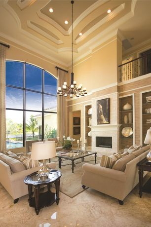 Traditional Living Room with Balcony, High ceiling, Chandelier, Crown molding, slate tile floors, Built-in bookshelf