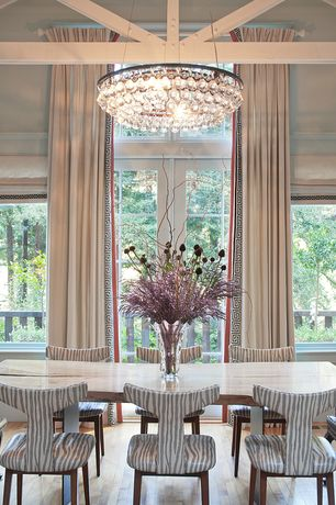 Eclectic Dining Room with French doors, Transom window, Cathedral ceiling, Exposed beam, Chandelier, Hardwood floors
