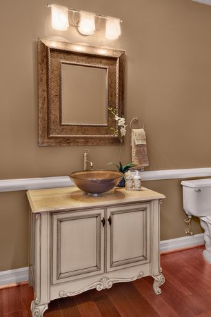 Traditional Powder Room with Hardwood floors, Vessel sink, Crown molding, Limestone counters, Powder room, Flush, Chair rail
