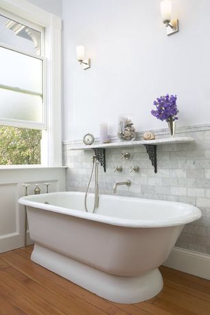 Traditional Master Bathroom with Gatco June 1 Light Wall Sconce, Carrara White 2x4 Grand Brick Subway Tile Polished
