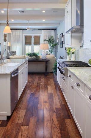 Traditional Kitchen with Exposed beam, Ella White Table Lamp, Pendant light, Ceiling fan, Built-in bookshelf, Hardwood floors