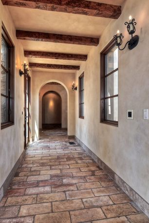 Mediterranean Hallway with French doors, Exposed beam, travertine floors, Wall sconce
