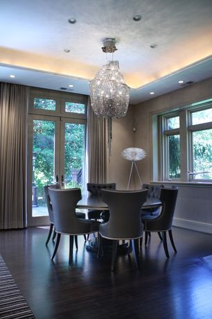 Contemporary Dining Room with Casement, can lights, French doors, Hardwood floors, Transom window, Standard height