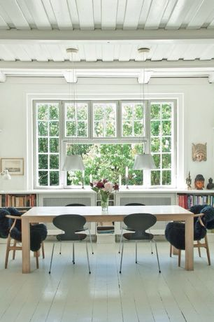 Modern Dining Room with Built-in bookshelf, Pendant light, Standard height, Chair rail, specialty window, Exposed beam