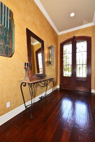 Mediterranean Entryway with Hardwood floors, Crown molding, French doors, interior wallpaper
