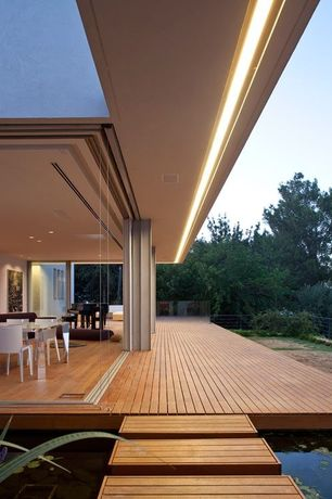 Contemporary Deck with NanaWall Frameless Glass Walls, Pathway, Fence