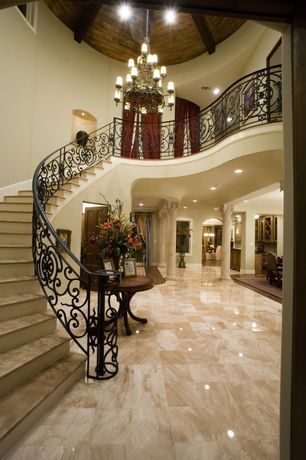 Traditional Staircase with High ceiling, can lights, picture window, curved staircase, Exposed beam, sandstone floors