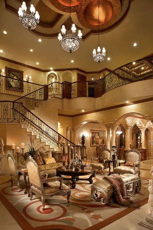 Traditional Living Room with travertine tile floors, Paint, Columns, Chandelier, can lights, stone tile floors, High ceiling