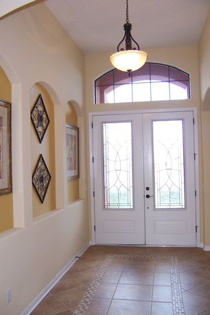 Traditional Entryway with Transom window, French doors, sandstone tile floors, Pendant light