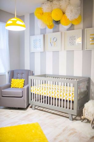 Contemporary Kids Bedroom with SKOJIG Pendant Lamp, Toys r us- kacy collection morgan nursery chair, Paint 1, Laminate floors