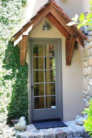 Cottage Front Door with exterior stone floors, French doors
