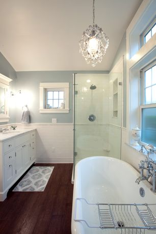 Traditional Master Bathroom with Built-in bookshelf, European Cabinets, Freestanding, Complex granite counters, Wall sconce