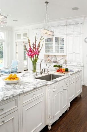 Traditional Kitchen with Undermount sink, Complex marble counters, Kitchen island, Transom window, Glass panel, Chandelier