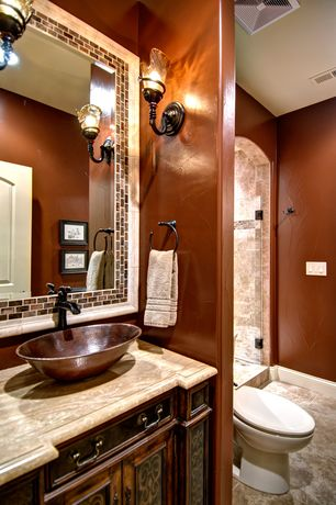 Mediterranean 3/4 Bathroom with Wall sconce, specialty door, Premier Copper Products Oval Wired Rimmed Vessel Bathroom Sink
