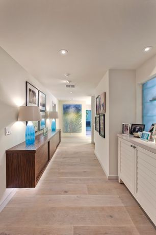 Contemporary Hallway with Hardwood floors, Built-in bookshelf