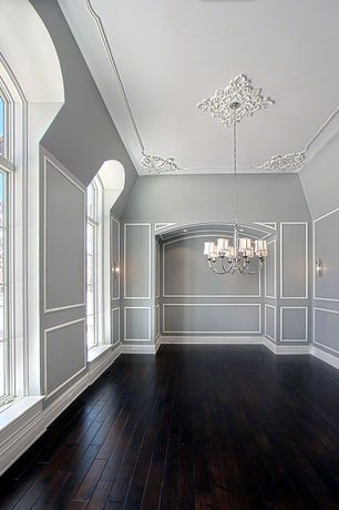Traditional Dining Room with Ceiling medallion, Eurofase Mona 8 Light Chandelier, Hardwood floors, Paint 1, Wall molding