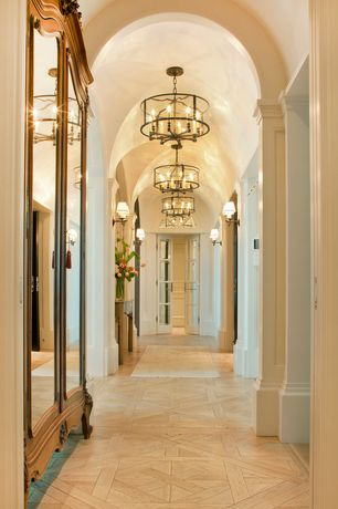 Traditional Hallway with Chandelier, French doors, Hardwood floors, Wall sconce, High ceiling, Built-in bookshelf