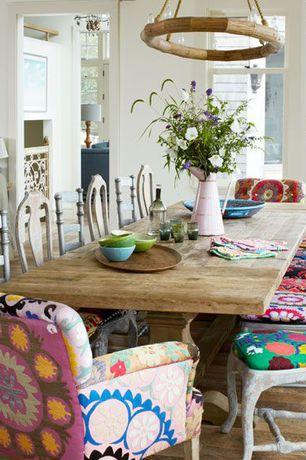 Traditional Dining Room with Hardwood floors, Glass panel door, Pendant light, Suzani Terai Folding Chair