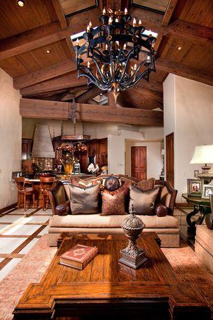 Mediterranean Great Room with Exposed beam, Hardwood floors, Chandelier, Built-in bookshelf, Skylight, sandstone floors