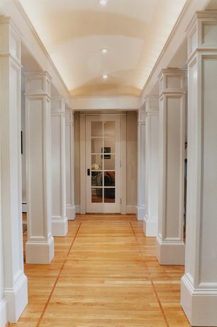 Traditional Hallway with Crown molding, Standard height, Hardwood floors, French doors, can lights, Columns