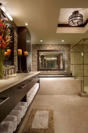 Contemporary Master Bathroom with Limestone counters, stone tile floors, full backsplash, linen and towel storage cabinet