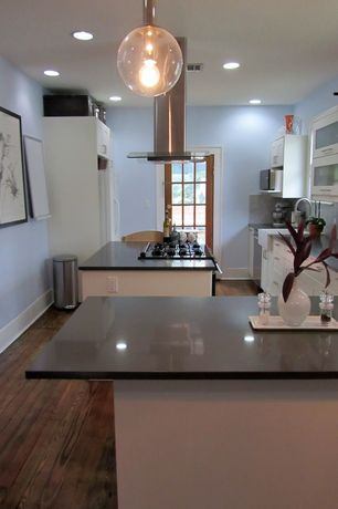 Contemporary Kitchen with Soapstone, Kitchen peninsula, Soapstone counters, built-in microwave, Island Hood, Standard height