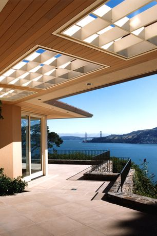 Contemporary Deck with exterior tile floors, French doors