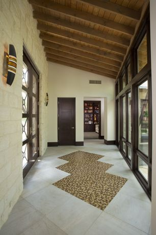 Modern Entryway with Wall sconce, French doors, Exposed beam, High ceiling, complex granite tile floors