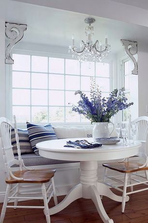 Cottage Dining Room with Window seat, Standard height, Chandelier, picture window, Hardwood floors