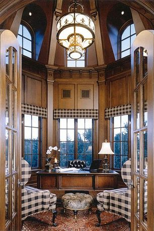 Traditional Home Office with High ceiling, Arched window, Oak wood paneling, can lights, Carpet, French doors, Chandelier