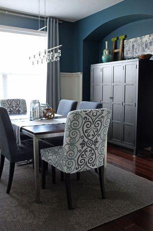 Modern Dining Room with Hardwood floors, Pendant light