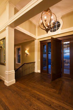 Traditional Entryway with Hardwood floors, Barn door, Crown molding, Chandelier, High ceiling
