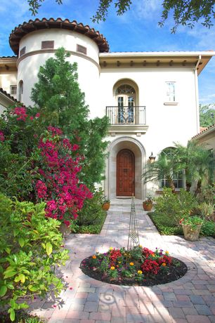 Mediterranean Landscape/Yard with Transom window, Exterior stucco walls, Casement, six panel door, French doors, Deck Railing