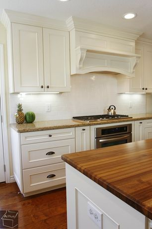 Traditional Kitchen with Paint 1, Hardwood floors, gas cooktop, Custom range hood, Subway Tile, Butcher block counter