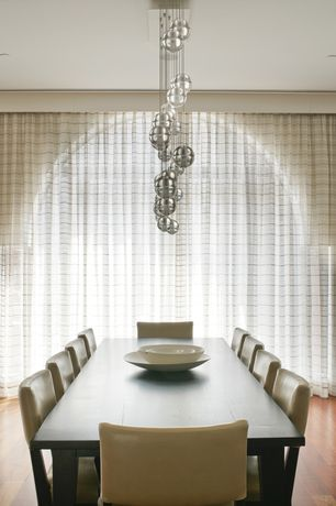 Contemporary Dining Room with Arched window, Sheer curtains, Striped sheer panel, Chandelier, Hardwood floors