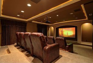 Traditional Home Theater with can lights, recessed lights, Standard height, Box ceiling, Carpet, Home theater seating, Paint