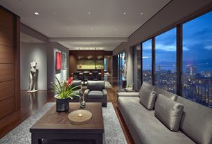 Modern Great Room with Hardwood floors, Pendant light, Moka Armchair, flush light, Supremax Deluxe Excess Lounger