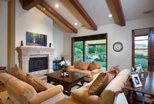 Traditional Living Room with Standard height, can lights, sliding glass door, Fireplace, Exposed beam, Hardwood floors