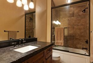 Craftsman Full Bathroom with Full Bath, Oiled soapstone laminate, stone tile floors, shower bath combo, Standard height