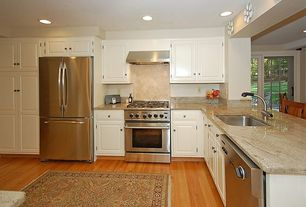 Traditional Kitchen with Built In Refrigerator, can lights, partial backsplash, gas range, Raised panel, Framed Partial Panel