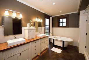 Craftsman Master Bathroom with Belle foret double ended cast iron tub with wood block feet, Crown molding, Wood counters