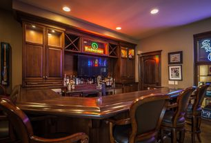 Traditional Bar with six panel door, High ceiling, can lights, Concrete floors