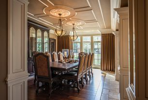 Traditional Dining Room with Standard height, Velvet beatrix dining chair, Crown molding, Casement, travertine floors, Paint