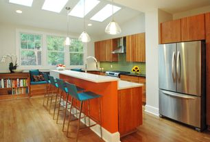 Modern Kitchen with Built-in bookshelf, European Cabinets, Simple marble counters, Kitchen island, Breakfast bar, Window seat