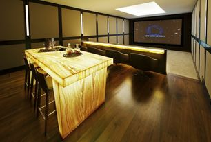 Contemporary Home Theater with Honey onyx, Skylight, Illuminated onyx apron leg island, Acoustic panel, Hardwood floors