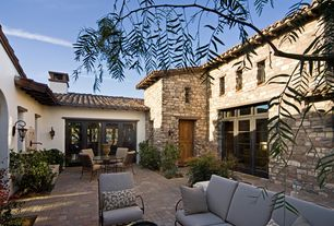 Mediterranean Patio with Outdoor furniture, Livex lighting bronze amwell large outdoor wall sconce with 2 lights