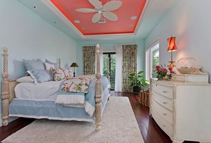 Tropical Master Bedroom with Spindle dresser, French doors, Floral drapes, Spindle bed, High ceiling, Ceiling fan, Bedding